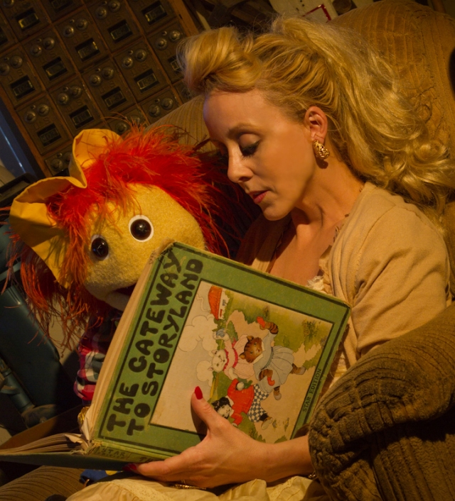christine marie reading a storybook to a puppet